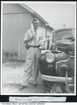 Image of Herschel D. Coleman by his car, Mishawaka, indiana, ca. 1945  - This was taken at his grandmother's farmhouse in the 200 block of West Battel.