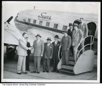 Image of Men by the Sears, Roebuck ans Co. corporate plane, Indiana, ca. 1950
