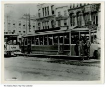 "Image of Photo of a streetcar at a station, Indianapolis, Indiana, ca. 1905 - Photo of streetcar #302 nearing a station. In the background are James Bogert Trunk Factory, and the Crystal Palace. Numbered 88806F and 296648F-4. Written on back is ""Illinois and Washington Streets, Stret ca, transfer car, early 1900s""."