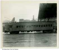 "Image of Photo of an Indiana Railroad streetcar, Indianapolis, Indiana, ca. 1920 - Photo of Indiana Railroad car #453 at the Indianapolis Traction Terminal. Several commercial buildings are visible in the background, including one with a ""Vaudeville"" sign."