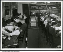 Image of Photo of editors at a newspaper office, Indianapolis, Indiana, 1946 - Photo showing several people editing newspaper columns and doing paste-up chores at the Indianapolis Star newspaper. A similar photo in this series is dated December, 1946.