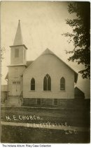 "Image of Methodist Episcopal Church, Burnettsville, Indiana, ca. 1910 -  Type on the transom windows read ""M.E. Church / Aug. 11, 1901."" Postmarked ""Burnetts Creek, Ind. / Aug. 29, 1910."""