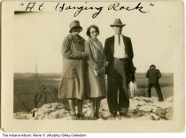 "Image of Murphy family at Hanging Rock near Lagro, Indiana, 1931 - Identified on the back as ""At Hanging Rock near Lagro, Spring 1931. Mr. and Mrs. George [Maude] Murphy and daughter Marie [later Gilley]."" The Hanging Rock is a limestone rock exposure on the Wabash River."