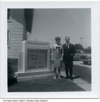 Image of Lebanon Evangelical United Brethren Church, Wabash, Wabash County, Indiana, 1966 - Pastor Roger Burk and his wife Sand stand near the marquee in front of the Lebanon Evangelical United Brethren Church (later the Lebanon United Methodist Church). The lender states that her family attended the church from at least the 1940s through 1989. It was later converted into a house.