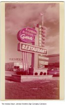 Image of Fairway Bamboo Room Cocktail Lounge sign, Decatur, Indiana, ca. 1960 - A Sinclair Service Station can also be seen in this photo.