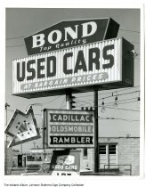 Image of Bond Used Cars sign, Indiana, ca. 1955 - Bond Top Quality Used Cars at Bargain Prices - Cadillac - Oldsmobile - Rambler