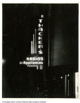 Image of Thacker's Radios and Appliances sign at night, Indiana, ca. 1955