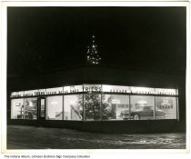 Image of Triers Hudson and International Harvester Dealership , Indiana, ca. 1945 - The Trier Implement Company was started in 1935 by Arthur W. Trier. He began selling Hudson automobiles in 1940. The building was later occupied by Main Bowling Lanes.