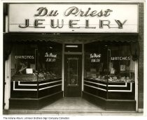 Image of Du Priest Jewelry store, Huntington,  Indiana, 1947 - A sign promotes the DePauw Choir and Men's Glee Club performing on Tuesday, April 8.  Photo is dated March 24, 1947.