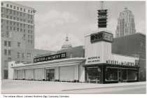 Image of Meyers & McCarthy Mens Store, Fort Wayne, Indiana, ca. 1955 - The Allen County Courthouse and the Lincoln Bank Tower are visible in the background.