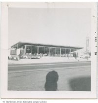 Image of Man standing in front of an unidentified furniture store, Indiana, 1959 - The photo was stamped Dec 59.