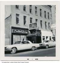 Image of Red Garter Cocktail Lounge, Fort Wayne, Indiana, 1965 - Trader's Cocktail Lounge is also seen in this photo, stamped Mar 64. The businesses were located on Berry and Harrison Streets in downtown Fort Wayne, across from the Van Orman Hotel. The building was destroyed in a fire in February of 1967.