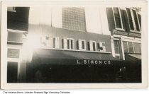 Image of L. Simon Co, Indiana, ca. 1960 - This sign for L. Simon Company was created by Johnson Brothers Sign Company of South Whitley. The Davis and Schaffer Law office was next door.