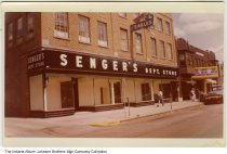 """Image of Senger's Department Store and Boice Theatre, Warsaw, Indiana, 1958 - A sign for the Eagles Lodge can be seen on the second floor. The marquee at the Boice Theatre advertises the Tab Hunter movie """"Gunman's Walk,"""" released in 1958."""