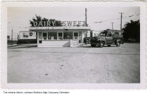 Image of Front of the Dairy Sweet Drive In restaurant, Fort Wayne, Indiana, ca. 1950s - A truck from the Johnson Brothers Sign Company is parked on the side of the restaurant.