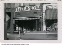 Image of The Style Shop Clothing, Indiana, ca. 1955 - This image shows the Style Shop before the new sign was installed. (see ia-0184-0194) Also seen in this image is Cherry's Lunches.