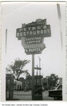 "Image of Petro's Restaurant sign, Warsaw, Indiana, ca. 1960 - A sign on South Detroit Street reads ""Indiana's Finest, Petro's Restaurant, Cocktail Lounge, 6 blocks."" A Shell service station and a phone booth are seen in the background."