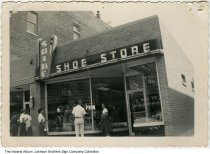 Image of Shine Shoe Store, Fort Wayne, Indiana, ca. 1960 - Several people are seen standing in front of the Shine Shoe Store.