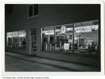 Image of Bashore Feed store at night, Rochester, Indiana, ca. 1950 - The Bashore Feed store was later known as the Walburn Feed store.
