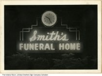 Image of Smith's Funeral Home sign at night, Indiana, ca. 1950