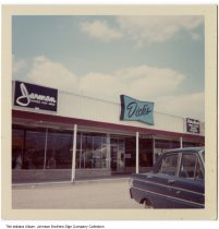 Image of Jarman Shoes and Dick's, Indiana, ca. 1960 - Stores seen are Jarman Shoes for Men, Dick's, and Palm Beach men's clothing.