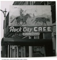 Image of Rock City Cafe sign, Wabash, Indiana, ca. 1960 - The neon sign shows a cowboy roping a steer with a lasso.