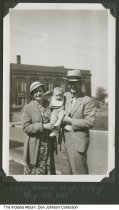 """Image of Annise, Morris, and Hugh Dickey, Indianapolis, Indiana, 1938 - """"Annise, Morris, Hugh Dickey / May 25, 1938."""" They stand on Blaine Avenue next to Marshall Dickey's IRGA (Independent Retail Grocers' Association) Food Market. In the background is the Indianapolis Lodge No. 669, Free and Accepted Masons at 1522 West Morris Street.   From a photo album compiled between 1935 and 1938 by Lee Wayne Dickey (1919-2003)."""