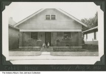 Image of Raymond and Paul Cobb in front of house, Indianapolis, Indiana, 1938 - From a photo album compiled between 1935 and 1938 by Lee Wayne Dickey (1919-2003). The boys are probably Raymond and Paul Cobb, sons of Ralph and Ida, posed in front of their house at 1841 West Lambert Street.