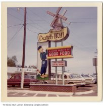"""Image of The Dutch Mill restaurant sign, Bluffton, Indiana, ca. 1955 - The sign reads, """"The Dutch Mill, a Large variety of good food, One dozen dining rooms."""""""