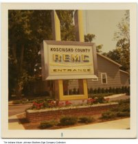 Image of Kosciusko County REMC sign, Warsaw, Indiana, ca. 1965 - The Kosciusko County Rural Electric Membership Corporation is located at 370 South and 250 East near Warsaw.