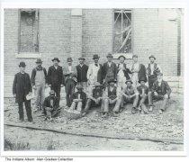 Image of Construction workers on the job, Indianapolis, Indiana, ca. 1880 - The man in the center in the white shirt was Mr. Clements, a general contractor who often worked on the south side of Indianapolis. He helped build Sacred Heart Church around 1875, but this is image does not show Sacred Heart Church.