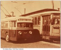 Image of East 10th Street bus and trolley, Indianapolis, Indiana, ca. 1940
