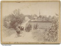 Image of St. Philomena Catholic Church, Oak Forest, Indiana, 1906 - A priest rides in a horse-drawn buggy leaving the small town of Oak Forest, Indiana. The church in the background was built in the 1870s and was later known as Saints Philomena and Cecelia Church. It is located at 16194 St. Mary's Road and the small town of Oak Forest is now part of Brookville in Franklin County.