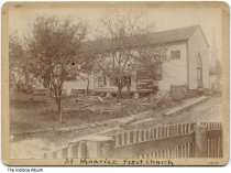 """Image of First Saint Maurice Catholic Church, Saint Maurice, Indiana, 1908 - This 1908 photograph identified as the """"St. Maurice First Church"""" might document the demolition of the structure. A steeple in the background is probably the new church, located at 1963 North Saint John Street in Greensburg. According to records of the Archdiocese of Indianapolis, St. Maurice Parish was founded in 1859 and closed in December 1, 2013, merging into the St. Catherine of Sienna Parish in Decatur County."""