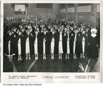 Image of St. John's School of Nursing Capping Ceremony, Anderson, Indiana, 1949 - Portrait of the Capping Ceremony at St. John's Hickey Memorial School of Nursing at Anderson, Indiana on February 6, 1949. Katherine (Annan) Zahm is in the 3rd row from the front, 2nd from the left.