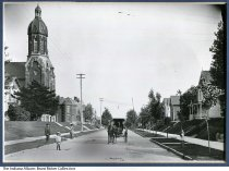 Image of Photo of Jefferson Street in Huntington, Indiana, ca.1911 - Photo looking south on Jefferson Street showing St. Mary's Catholic Church on the left, and John Gibler's residence at 946 N. Jefferson on the right. The family in the photo is unknown.