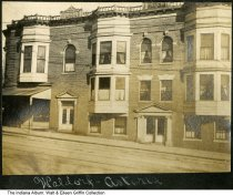 """Image of Kron Block Apartments, Lafayette, Indiana, ca. 1920 - This photo shows the Kron Block apartment house that was located on the northeast corner of West State Street at Main Street. The caption under the image in a photo album reads """"Waldorf Astoria."""""""