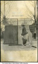 """Image of Thieme and Wagner Beer outdoor display, Lafayette, Indiana, ca. 1905 - A shield-shaped sign for Thieme & Wagner beer on an outdoor booth that reads """"A short circuit between bars - Bus bar - commutator bar."""""""