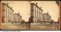 Image of Federal Building and Post Office, Indianapolis, Indiana, ca. 1880 - This stereoview shows the Post Office building (also known as the Federal Building and Courthouse)  that was located on the southeast corner of Market and Pennsylvania streets. A sign for WIlliam Selking and Wallader's Photography studio.