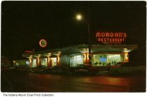 Image of Postcard of Morgan's Restaurant, Indianapolis, Indiana, ca. 1960 - Postcard showing the exterior of Morgan's Restaurant at night. The neon sign and neon clock are both lit.
