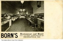 Image of Postcard of Born's Restaurant interior, Indianapolis, Indiana, ca. 1915 - Black and white postcard showing several workers behind the counter at Born's Restaurant and Hotel.