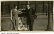 "Image of Photo of a sign for the Schubert Murat Theater, Indianapolis, Indiana, ca.1920 - Snapshot showing a woman and a man standing by a placard advertising a play entitled ""She Walked in Her Sleep"" at the Schubert-Murat Theater in Indianapolis. The date listed in Monday, January 27."