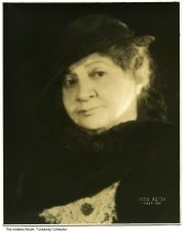 """Image of Portrait of Indianapolis resident Nellie Simmons Meier, ca. 1920 - Nellie Simmons Meier was the owner of Tuckway House on 3128 North Pennsylvania Street in Indianapolis, a noted salon for world-renowned artists and celebrities.  She was the author of """"Lions' Paws: The Story of Famous Hands"""", a collection of essays about the personality profiles she created for many famous people by reading the lines on their palms."""