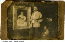 """Image of WIlliam Merritt Chase painting in his New York City studio, ca. 1910 - This photo is in an H. Lieber Company envelope marked """"Film of W. M. Chase - Studio photo - 1910 in N. Y. taken by Howard McCormick of Leonia, N. J."""" The artist, seen here with his trademark walrus mustache and pince-nez eyeglasses, poses with his palette and brush next to a framed portrait of a girl holding a doll. Written on the mount is """"Studio photo of W. M. Chase in NY / Property of Mrs. Geo. P. Meier [Nellie Simmons Meier]  / 838 Del [Delaware] St / Indianapolis Ind."""""""