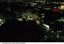 Image of Night view of downtown Indianapolis, Indiana, 1969 - The photo was taken from the top of the Bell Telephone (later AT&T) building. It is looking south/southeast; the intersection of Illinois and Ohio is at the bottom. The State Capitol building is seen on the upper right.