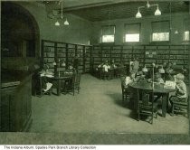 Image of Interior of Spades Park Library, Indianapolis, Indiana, ca. 1935 - Children are seen reading at tables inside the Spades Park Library branch.