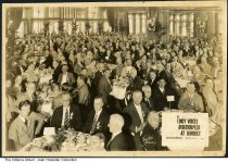 """Image of Charles Lindbergh speaking at a banquet, Indianapolis, Indiana, 1927 - A large group of men are seen inside a banquet hall, including speaker Charles Lindbergh (who is indicated by an arrow). The caption reads """"Lindy voices aviation plea at banquet, Indianapolis, August 9, 1927."""""""