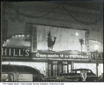 "Image of Hill's Department Store Christmas decorations, Marion, Indiana, ca. 1940 - Christmas lights and a wise man mural decorate Hill's store in Marion, Indiana. The sign reads ""Once again it is Christmas."" The photo came a portfolio documenting the projects of sign maker Lyle Reith."