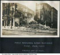 "Image of First National Bank fire, Indiana, 1920 - The photo shows the aftermath of a large fire. The caption reads ""First National Bank Building fire, Mar. 1920. Coldest day of the year. Sunday."" From a photo album owned by the Reith family of Marion, Indiana."
