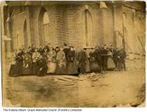 Image of Grace Methodist Episcopal Church, Franklin, Indiana, 1868 - Parshioners are seen standing before the Grace Methodist Episcopal Church during its construction.  Some of the people seen are Carl Sandefur, John Hutchinson, Dr. D. H. Miller, McClain, Mr. & Mrs. Will Dunlap, L. W. Knobe.